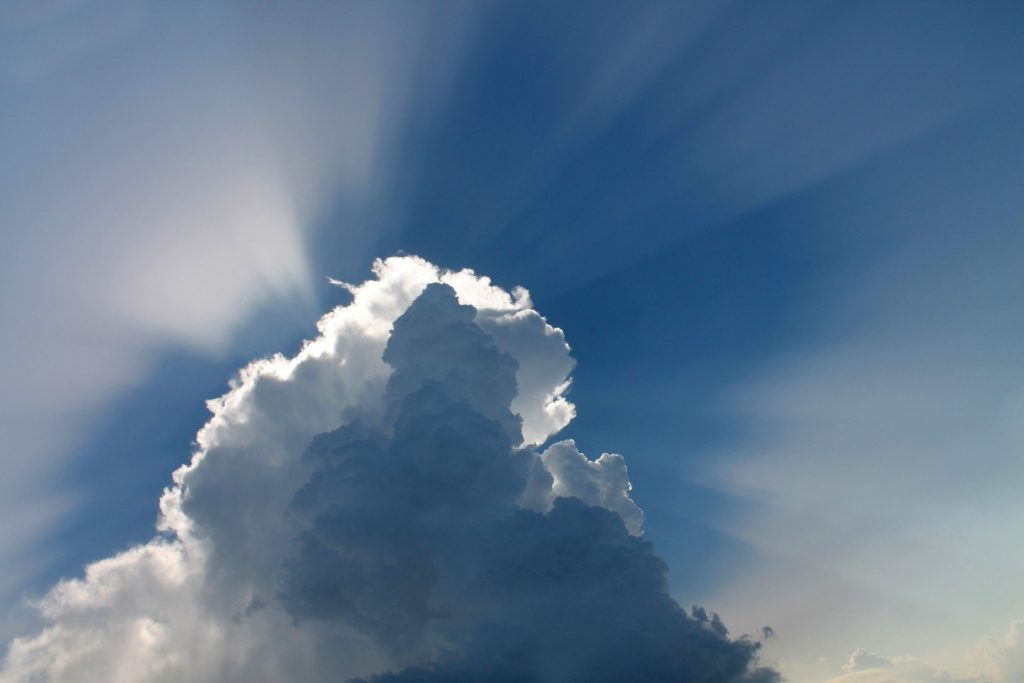 low-angle-view-of-clouds-and-sunbeam